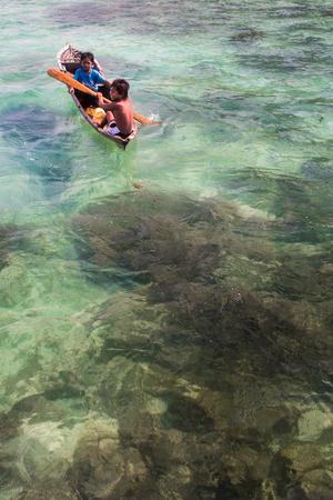 mabul: Sea Gypsy Kids on their sampan