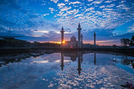 bukit: Relfection of a Mosque and Clouds at sunrise - masjid tengku ampuan jamaah shah alam