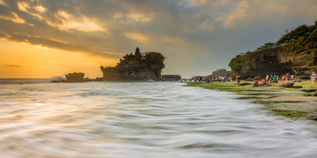 ulun: Pattern of Waves - Sunset at Tanah Lot Stock Photo