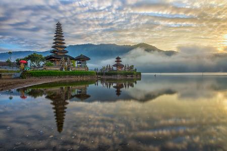 bratan: A reflection of a pura temple at sunrise - Pura Ulun Danu Bratan