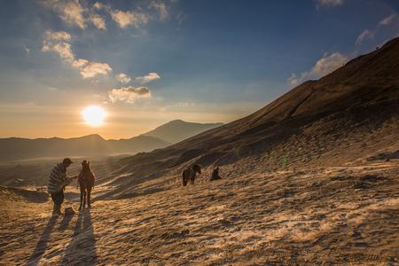handler: Horse and Handler at Sunrise in the desert - Bromo Tengger Semeru National Park