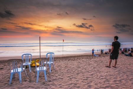 kuta: Tourist viewing sunset at Kuta Beach, Bali. Editorial