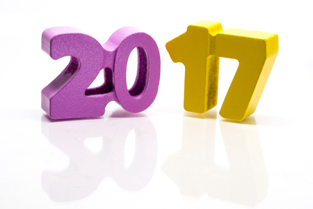 17 years: Happy New Year 2017. Block of numbers on white background, seamless with reflection Stock Photo