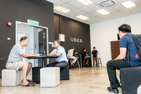 Kuala Lumpur, Malaysia, Circa 2016 - UBER partners waiting to be entertained at Kuala Lumpur Partners' Service Centre. UBER is a rideshare facility where users can earn money by becoming a driver. 에디토리얼