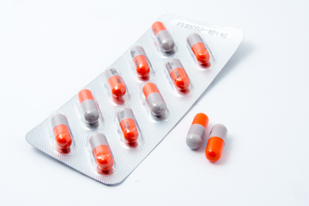 Colorful pills on a white background.