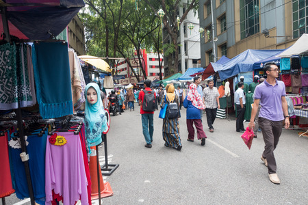 Malaysia, Circa 2017 - Malaysians walking and shopping at Tunku Abdul Rahman Street, a famous street during Ramadan for Eid preparation
