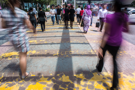 Motion Blur - People crossing the road. Blurry effect to illustrate movement