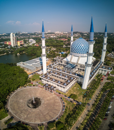 Aerial Photo - Blue Dome Mosque in the morning, Sultan Salahuddin Abdul Aziz Shah Mosque, Malaysia. Arabic writings read God is Great