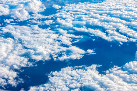 Clouds and blue sky. View from a plane