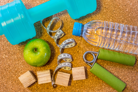 customizable: Lay Flat - Dumbbell, Fresh Apple, Measuring Tape, Mineral Water & Blank Wooden Cubes, customizable for New Year. Fitness & Healthy Eating Concept