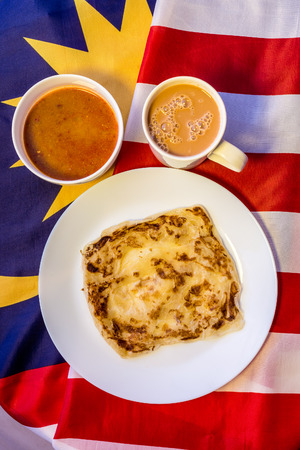 frothy: Malaysia Food - roti canai and teh tarik, very famous drink and food on Malaysia Flag. Stock Photo