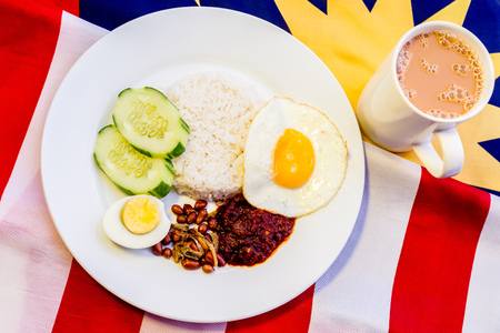 Malaysian Breakfast - Nasi Lemak and Teh Tarik on Malaysia Flag. Both dishes are unofficially the national breakfast dish of Malaysia