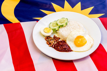 Malaysian Breakfast - Nasi Lemak on Malaysia Flag. It is unofficially the national breakfast dish of Malaysia. Shallow depth of field.