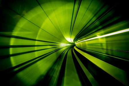 Motion Blur Abstract - in an underground tunnel heading towards a light. Green Colour