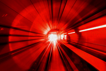 Motion Blur Abstract - in an underground tunnel heading towards a light. Red Colour