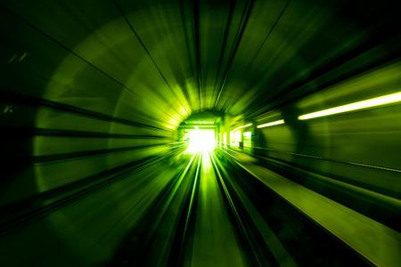 モーションぼかし要約 - 光に向かう地下トンネル緑の色 写真素材