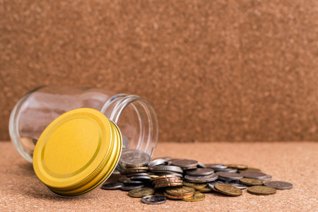 Malaysia Ringgit Coins and wood background. On the ground out of the jar. Shallow depth of field Stock Photo