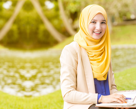 Muslim BusinesswomenEntrepreneurs Smiling and looking into the camera. Stock Photo
