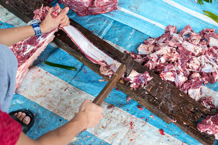 Butchering Cows Meat during Eid Adha, The festival of Sacrifice Stock Photo