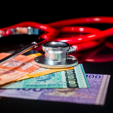 Financial Health/Insurance Concept - Ringgit Malaysia. Shallow depth of field Stock Photo - 85891328