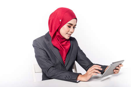 Muslim Female in Business attire isolated on white with her smartphone gadgets