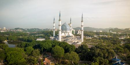 Aerial Panorama - Sultan Salahuddin Abdul Aziz Shah Mosque at sunrise Stock Photo