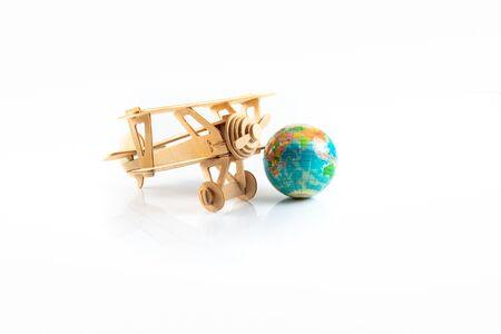 Model Aeroplane and World Globe. Travel Concept. Isolated on white background Stock Photo