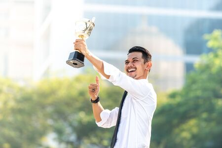 Malay Businessman wins a trophy. Top employee concept