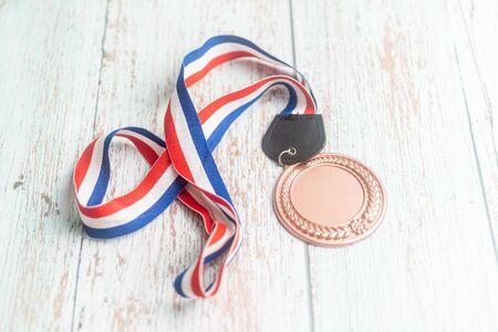 Sport Medal on wooden background.