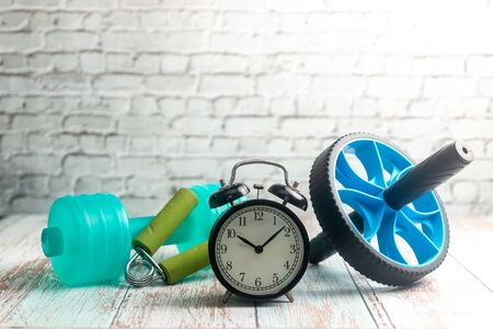 Fitness Equipment on Wooden Background. Shallow depth of field Imagens