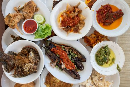 """The famous """"Nasi Padang"""" in Indonesia. Rice is served with many dishes like chicken, beef, mix vegetables and eggs."""