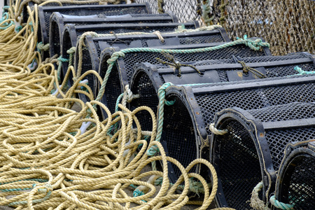 lobster pot: Lobster Pots lined up at Mudeford Harbour Dorset Stock Photo