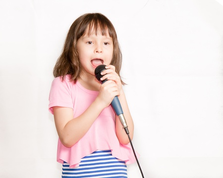 Child singing with microphone photo