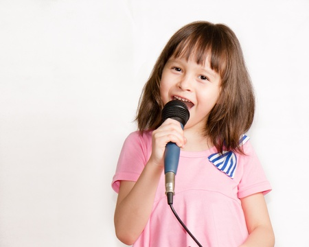 Child with microphone photo