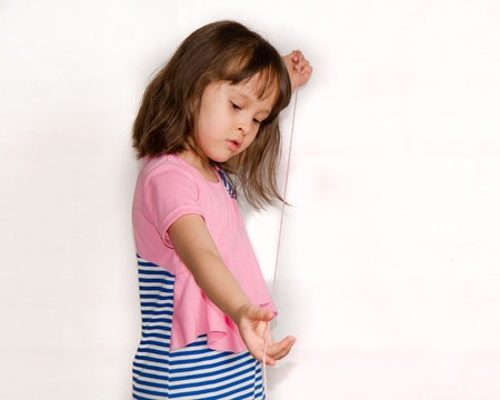 Child playing with string