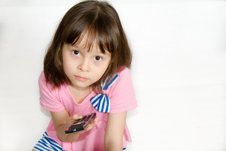 Asian Child with Remote control Foto de archivo