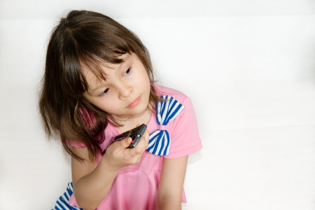 Asian Child with Remote control photo