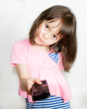 Asian Child with Remote control Stock Photo
