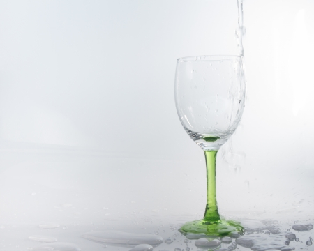 signle: water splashing into a wineglass Stock Photo
