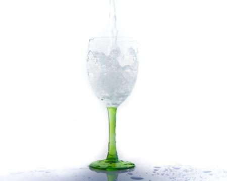 water splashing into a wineglass Stock Photo