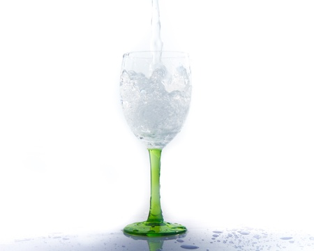 signle: water splashing into a wineglass Stock Photo
