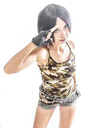 Asian female in army clothing on isolated white background