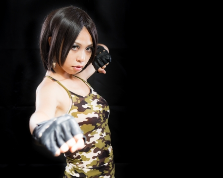 Asian female in army clothing on isolated background