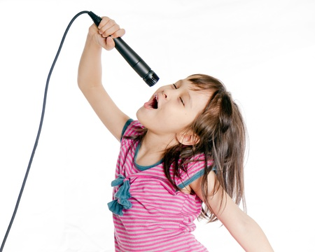 karaoke: Asian female child singing with a microphone