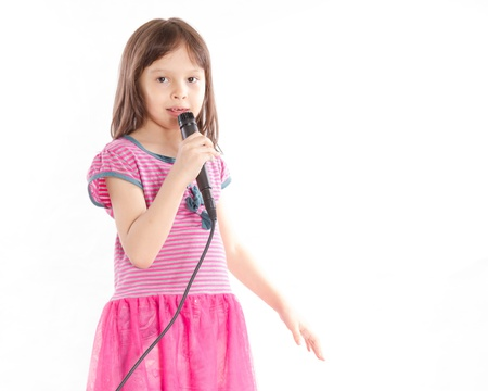 Asian female child singing with a microphone
