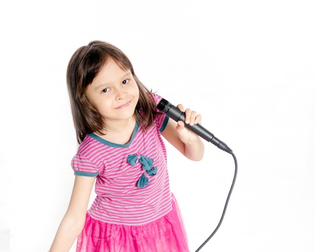 Asian female child singing with a microphone photo