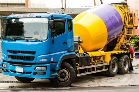 Cement truck parked outside a buiding