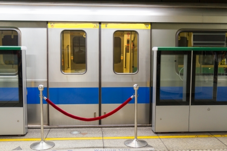 MRT with red rope barrier in front of the closed doors