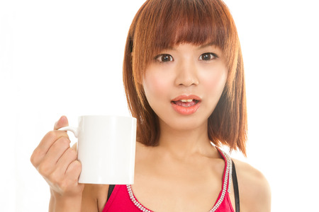 Chinese female with white coffee cup photo