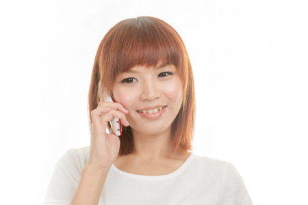 cordless phone: Asian female holding cordless phone